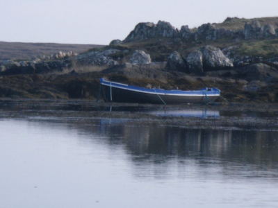 Rowing boat on shore seen when kayaking with Roundstone Outdoors in Connemara