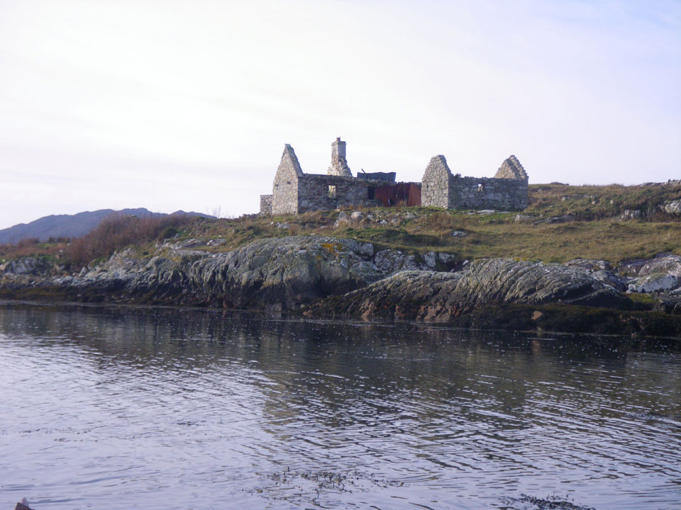 Ruins on the shore seen kayaking with Roundstone Outdoors